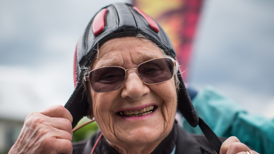 Etta Hellyer, 90, puts on a helmet before performing a tandem skydive as part of a fundraiser for a new seniors care home and hospital, in Abbotsford, B.C., on June 8, 2019. (The Canadian Press/Darryl Dyck)
