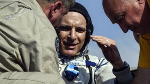 Russian space agency rescue team help CSA astronaut David Saint Jacques to get from the capsule shortly after the landing of the Russian Soyuz MS-11 space capsule about 150 km (80 miles) south-east of the Kazakh town of Zhezkazgan, Kazakhstan, Tuesday, June 25, 2019. A Soyuz space capsule with U.S. astronaut Anne McClain, Russian cosmonaut ?leg Kononenko and Canadian astronaut David SaintJacques, returning from a mission to the International Space Station landed safely on Tuesday on the steppes of Kazakhstan. (Alexander Nemenov / Pool Photo via AP)