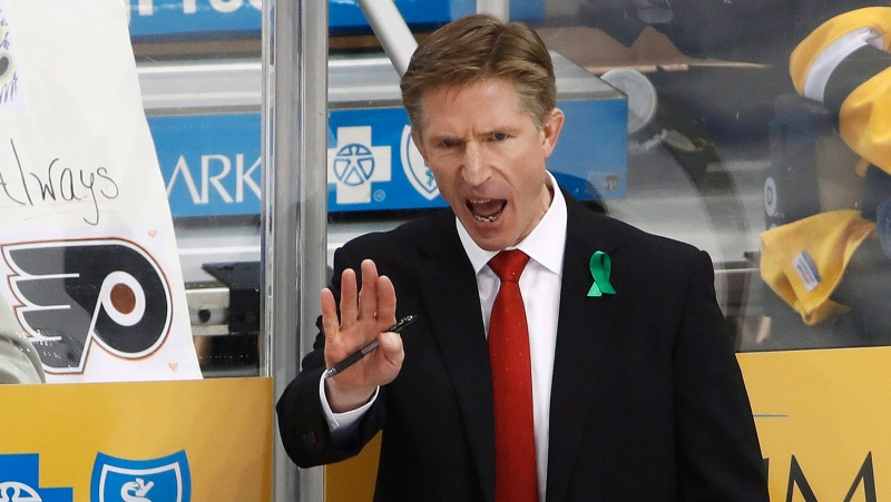 FILE - In this April 13, 2018, file photo, Philadelphia Flyers head coach Dave Hakstol gives instructions during the third period in Game 2 of an NHL first-round hockey playoff series against the Pittsburgh Penguins, in Pittsburgh. (AP Photo/Gene J. Puskar, File)