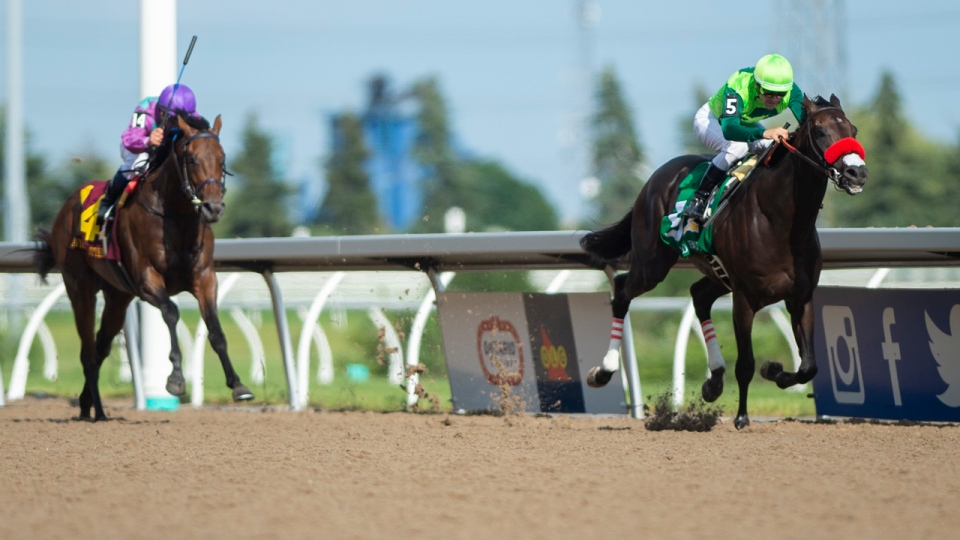 One Bad Boy (5), ridden by jockey Flavien Prat, wins the 160th running of the Queen's plate in Toronto on Saturday, June 29, 2019. THE CANADIAN PRESS/Andrew Lahodynskyj