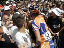 Rabobank team cyclist Michael Boogerd of the Netherlands lashes out at a spectator who was taunting him prior to the 17th stage of the Tour de France on Thursday, July 26, 2007. (AP / Christophe Ena)