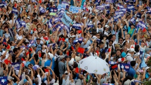 Pro-China's supporters hold Chinese flags