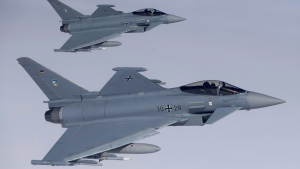 German Eurofighter Typhoon fighter jets participate in NATO's Baltic Air Policing Mission operate in Lithuanian airspace during an air force exercise on April 25, 2017. (Mindaugas Kulbis / THE CANADIAN PRESS / AP)