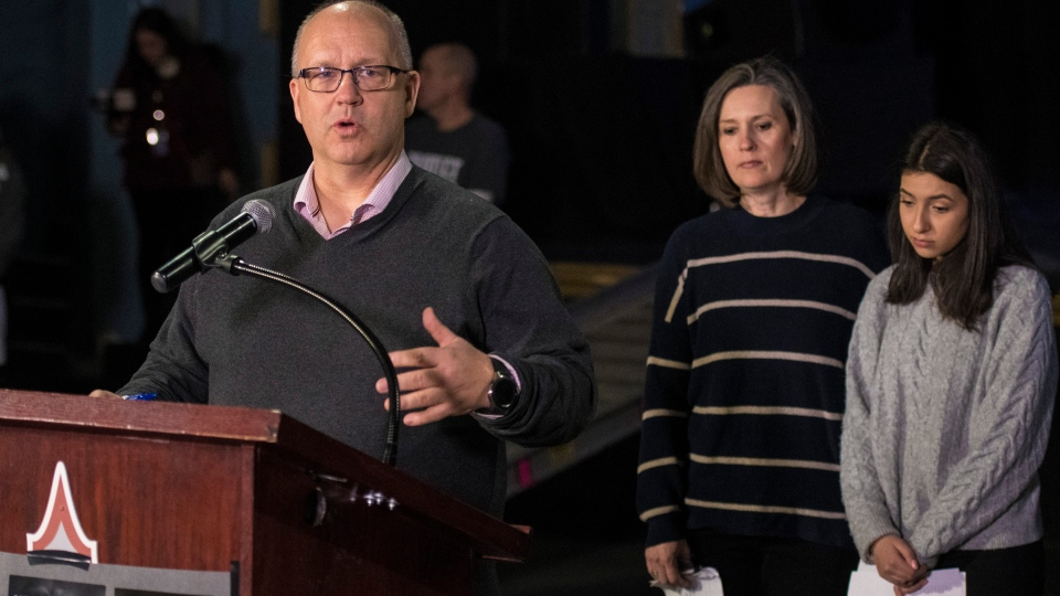Ken Price and Claire Smith, the parents of Samantha Price and Danforth Avenue shooting survivor Noor Samie, right, respond to the media during their first public statement as a group at the Danforth Music Hall in Toronto on Friday, February 22, 2019. THE CANADIAN PRESS/ Tijana Martin