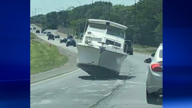 A boat blocking the westbound lanes of EC Row