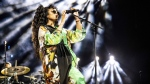 FILE - In this April 14, 2019 file photo, H.E.R. performs at the Coachella Music & Arts Festival at the Empire Polo Club in Indio, Calif. (Amy Harris / Invision / AP)