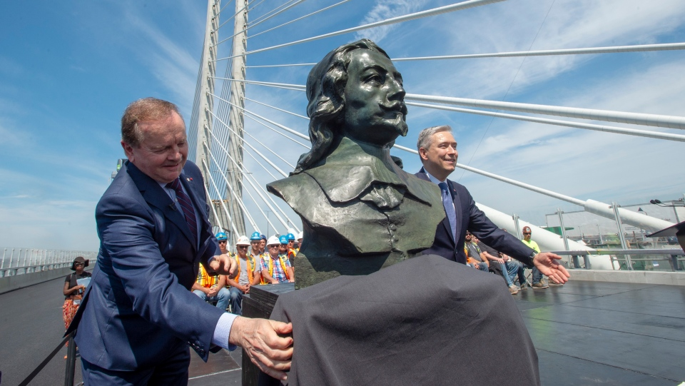 Infrastructure and Communities Minister Francois-Philippe Champagne, right, and former senator Serge Joyal, left, unveil a bust of Samuel de Champlain during the official inauguration of the new Samuel de Champlain Bridge in Montreal on Friday, June 28, 2019. (THE CANADIAN PRESS/Ryan Remiorz)