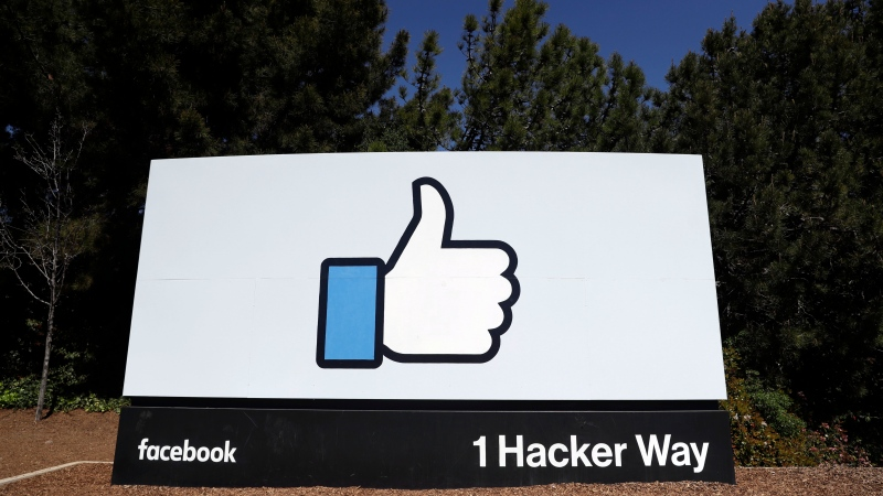 In this file photo taken March 28, 2018, the Facebook logo is shown on a sign at the company's headquarters in Menlo Park, Calif. (AP Photo/Marcio Jose Sanchez, File)
