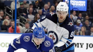 The Winnipeg Jets shored up their blue-line depth Monday, signing defenceman Nathan Beaulieu (88), pictured in this Canadian Press file image taken March 5, 2019, to a one-year contract worth US$1 million. (AP, Chris O'Meara)