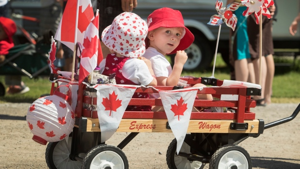 People enjoy Canada Day celebrations in Bobcaygeon Ont. on Monday, July 1, 2019. (THE CANADIAN PRESS / Fred Thornhill)