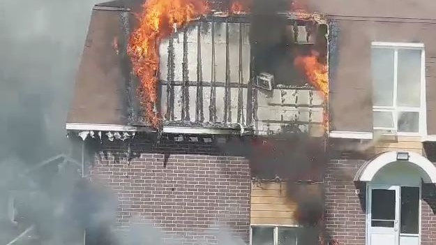 Fire crews respond to an apartment building in Bathurst, N.B., on July 1, 2019. (Submitted: Lisa Chamberlain)