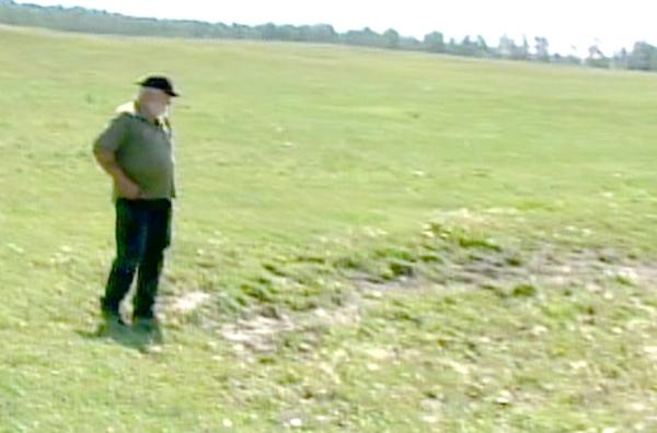 Cattle farmer Seth Barnfield looks over the pasteurs on his farm near Teepee Creek, Alta. on Sunday, Aug. 16, 2009.