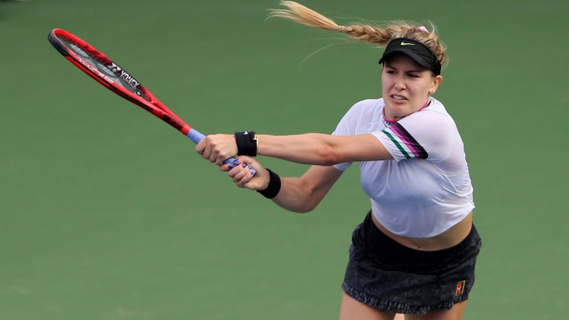 Canada's Eugenie Bouchard returns the ball to Romania's Simona Halep during a match of the Dubai Duty Free Tennis Championship in Dubai, United Arab Emirates, Tuesday, Feb. 19, 2019. (AP Photo/Kamran Jebreili)