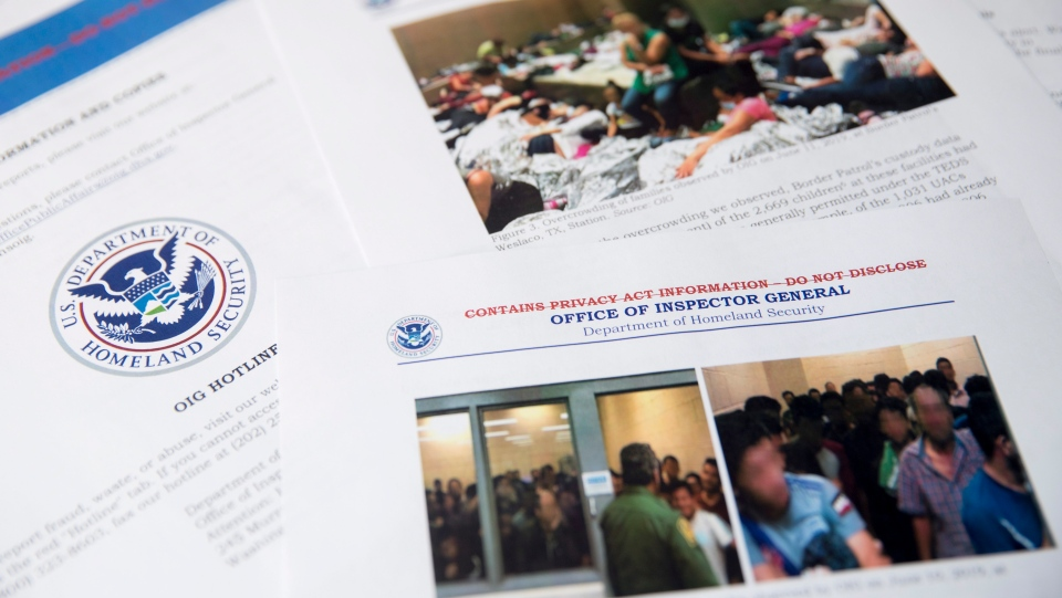 A report from government auditors reveals images of people penned into overcrowded Border Patrol facilities, including one man pressing a cardboard sign to a cell window with the word 'help.' is photographed at the Associated Press Bureau, Tuesday, July 2, 2019, in Washington.  (AP Photo/Andrew Harnik)