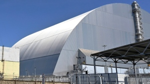 FILE - This June 1, 2019, file photo shows a view of the New Safe Confinement (NSC) movable enclosure at the nuclear power plant in Chernobyl, Ukraine. (Sergei Supinsky/Pool Photo via AP, File)