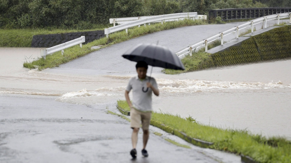 A flooded road is seen during heavy rain in Soo City, Kagoshima Prefecture, southwest Japan, on July 3, 2019. (Kyodo News via AP)