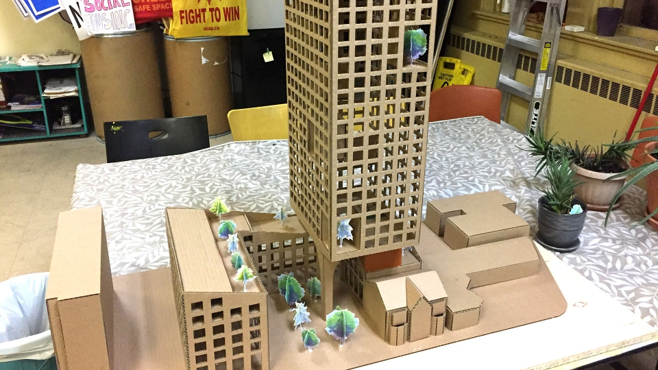 A model for a possible affordable housing building on Sherbourne Street is unveiled by the Ontario Coalition Against Poverty (OCAP) and Open Architecture Collaborative Toronto Wednesaday July 3, 2019. (CTV News Toronto / Brandon Rowe)