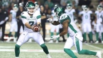 Saskatchewan Roughriders quarterback Cody Fajardo (7) hands off the ball to teammate Marcus Thigpen (8) during second half CFL football action against the Ottawa Redblacks, in Ottawa, Thursday, June 20, 2019. THE CANADIAN PRESS/Fred Chartrand