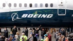 In this Feb. 5, 2018, file photo a Boeing 737 MAX 7, the newest version of Boeing's fastest-selling airplane, is displayed during a debut for employees and media of the new jet in Renton, Wash. (AP Photo/Elaine Thompson, File)