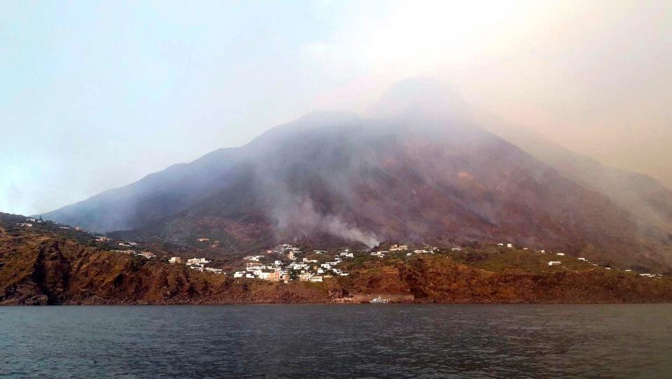 Smoke billows from the volcano on the Italian island of Stromboli, Wednesday, July 3, 2019. (ANSA VIA AP)
