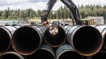 Pipe for the Trans Mountain pipeline is unloaded in Edson, Alta. on June 18, 2019. (THE CANADIAN PRESS / Jason Franson)