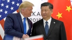 U.S. President Donald Trump, left, shakes hands with Chinese President Xi Jinping during a meeting on the sidelines of the G-20 summit in Osaka, Japan, Saturday, June 29, 2019. (AP Photo/Susan Walsh)