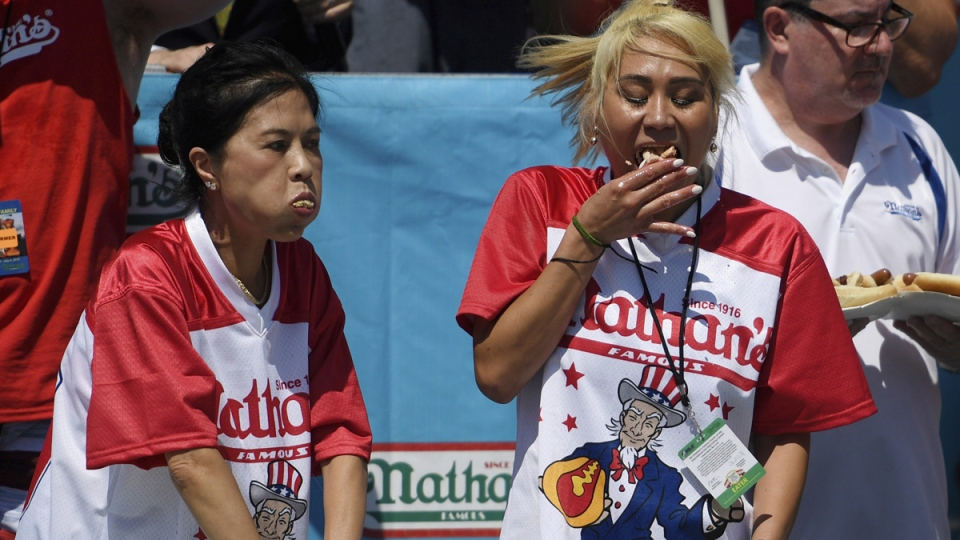 Juliet Lee, left, and Miki Sudo, right, compete in the women's competition of Nathan's Famous July Fourth hot dog eating contest, on July 4, 2019. (Sarah Stier / AP)