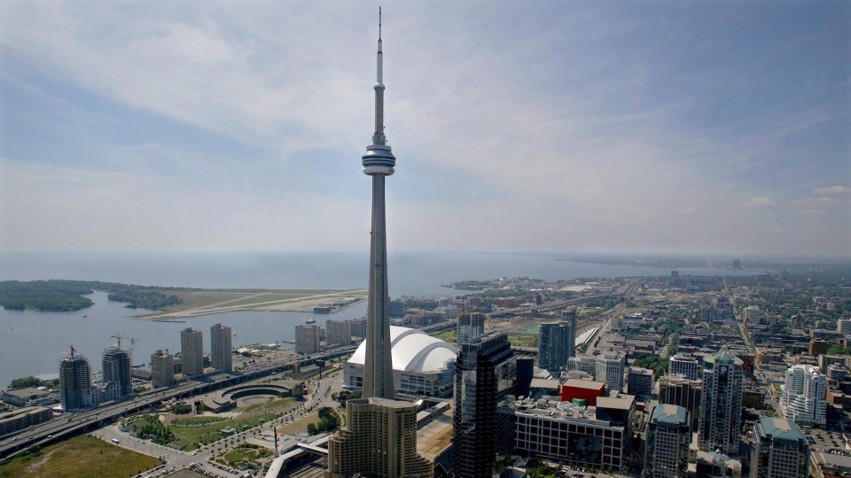 FILE--The CN Tower and Skydome are seen on Lake Ontario in Toronto Monday August 26, 2002. (THE CANADIAN PRESS/Kevin Frayer)