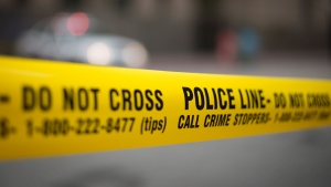Police tape is shown in the photo. (Graeme Roy / THE CANADIAN PRESS)