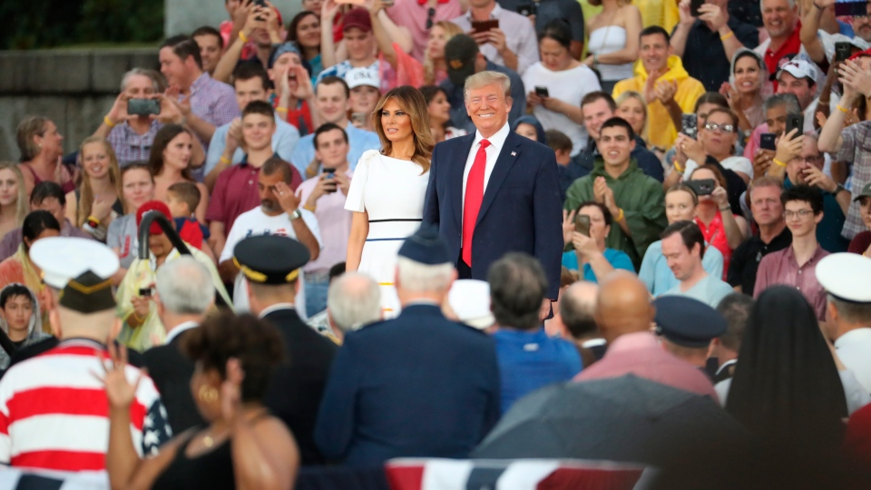 U.S. President Donald Trump and first lady Melania Trump, arrives speaks to an Independence Day celebration in front of the Lincoln Memorial in Washington, Thursday, July 4, 2019. (AP Photo/Andrew Harnik)