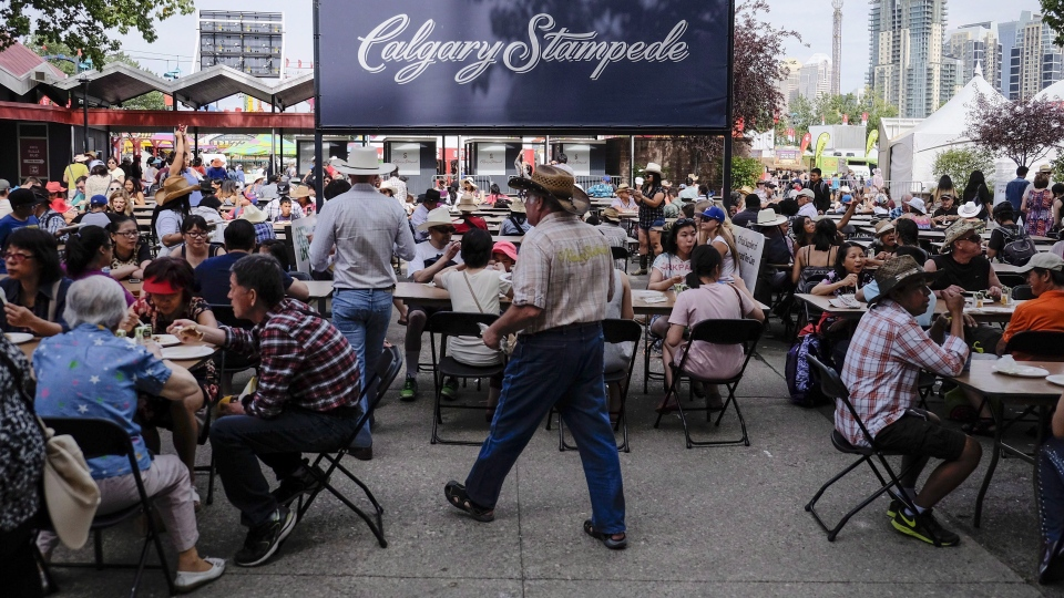 The first 25,000 visitors to the Calgary Stampede received tickets to a free pancake breakfast in Calgary on July 9, 2017. THE CANADIAN PRESS/Jeff McIntosh
