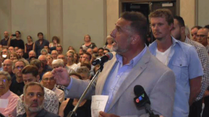 Roxboro-Pierrefonds Mayor Jim Beis gave a rousing speech defending flood victims.