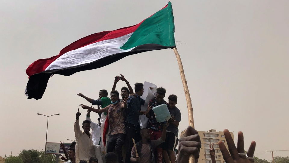 FILE - In this June 30, 2019, file photo, Sudanese protesters shout slogans as they march during a demonstration against the military council, in Khartoum, Sudan. (AP Photo/Hussein Malla, File)