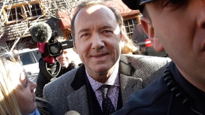 In this Jan. 7, 2019 file photo, actor Kevin Spacey arrives at district court in Nantucket, Mass. A young man who says Kevin Spacey groped him in a Nantucket bar in 2016 has dropped his lawsuit against the Oscar-winning actor. Mitchell Garabedian, an attorney for the man, announced in an email Friday, July 5,  that the suit filed June 26 in Nantucket Superior Court has been voluntarily dismissed.(AP Photo/Steven Senne)