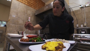 Chef Norma Condo plates dishes in the kitchen of Miqmak Catering Indigenous Kitchen, a new restaurant that gives a new twist on traditional Indigenous cuisine.