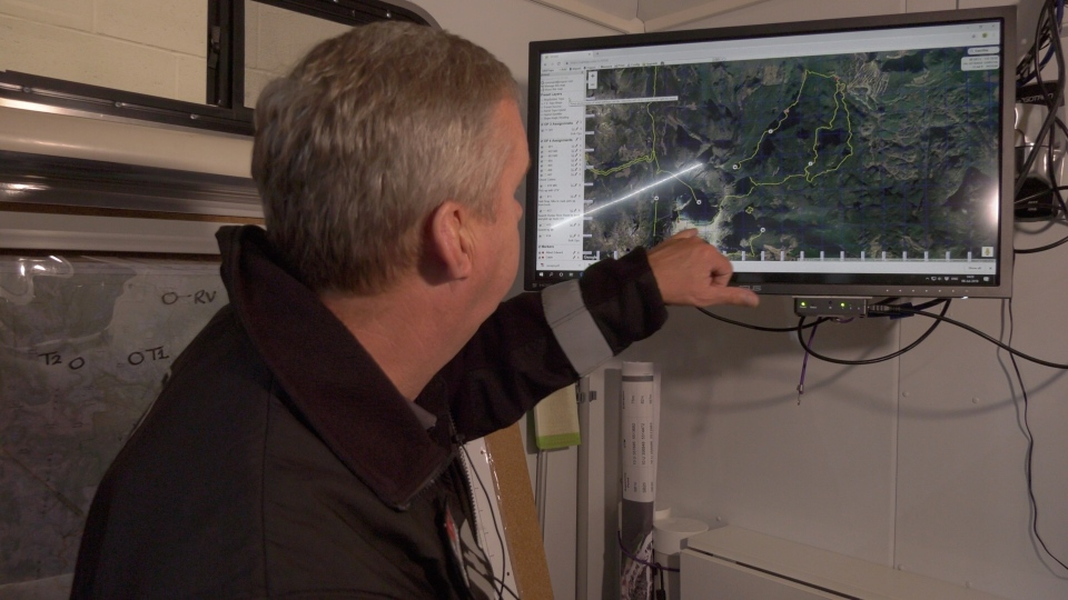 Comox Valley Ground Search and Rescue team leader Paul Berry points to a map of Strathcona Park on Saturday. (CTV)