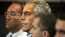 In this July 30, 2008 file photo, Jeffrey Epstein, center, is shown in custody in West Palm Beach, Fla. (Uma Sanghvi/Palm Beach Post via AP, File)