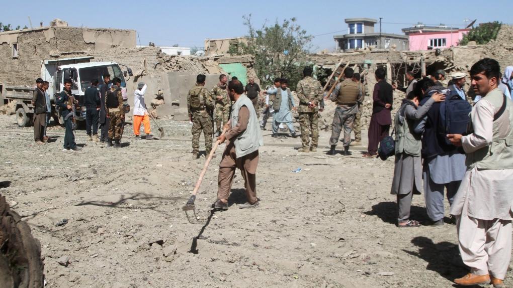 Afghan officials say car bomb kills 12, wounds scores | CTV News