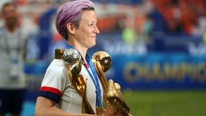 United States' Megan Rapinoe carries her individual awards at the end of the Women's World Cup final soccer match between the U.S. and The Netherlands at the Stade de Lyon in Decines, outside Lyon, France, Sunday, July 7, 2019. (AP Photo/Francisco Seco)