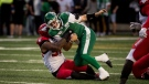 Saskatchewan Roughriders quarterback Cody Fajardo (7) is pulled down by Calgary Stampeders defensive end Chris Casher (96) during first half CFL action in Regina on Saturday, July 6, 2019. THE CANADIAN PRESS/Matt Smith