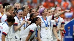 United States' Megan Rapinoe, center, celebrates team's victory with teammates after the Women's World Cup final soccer match between US and The Netherlands at the Stade de Lyon in Decines, outside Lyon, France, Sunday, July 7, 2019. US won 2:0. (AP Photo/David Vincent)