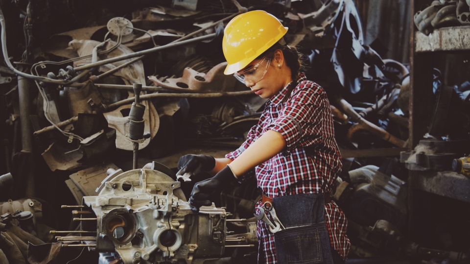 A factory worker uses a machine in this file photo. (Chevanon Photography / Pexels)