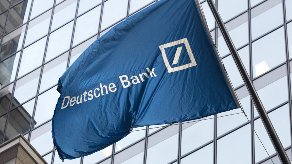A flag for Deutsche Bank flies outside the German bank's New York offices on Wall Street, on Oct. 7, 2016. (Mark Lennihan / AP)