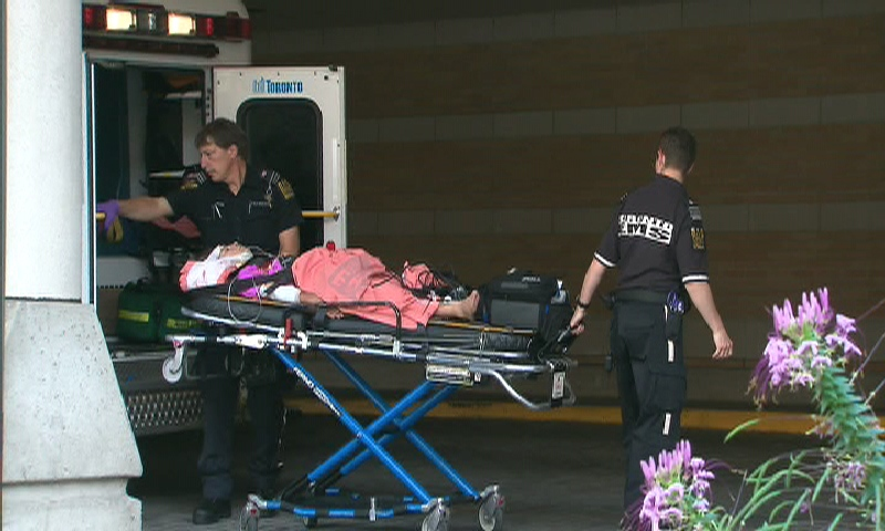 A 13-year-old boy arrives at the Hospital for Sick Children after an unmarked police cruiser struck him while he was riding a skateboard near Keele Street and Glenlake Avenue on Monday, Aug. 17, 2009.
