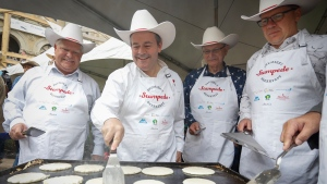 Alberta Premier Jason Kenney, second left, hosts a Stampede breakfast with visiting premiers, left to right, Doug Ford, of Ontario, Blaine Higgs, of New Brunswick, and Scott Moe, of Saskatchewan, in Calgary, Monday, July 8, 2019.THE CANADIAN PRESS/Jeff McIntosh