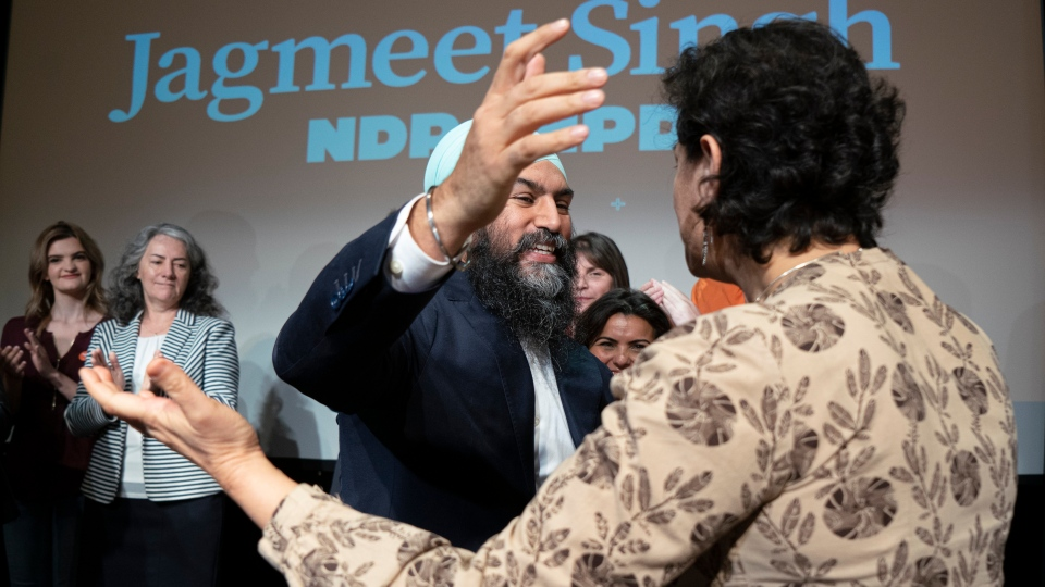NDP Leader Jagmeet Singh embraces a candidate as he presents the party's plan for climate change in Montreal on Friday, May 31, 2019. THE CANADIAN PRESS/Paul Chiasson