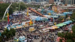 Crowds flock to the midway at the Calgary Stampede in Calgary, Sunday, July 7, 2019. THE CANADIAN PRESS/Jeff McIntosh