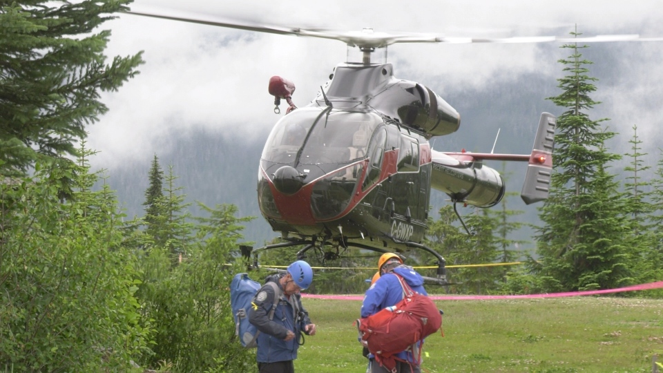 A helicopter takes rescuers into the search area to try to locate missing hiker Murray Naswell. (CTV Vancouver Island)