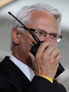 B.C. Premier Gordon Campbell talks to a train control centre while waiting to board the inaugural run of Canada Line rapid transit train at Vancouver International Airport in Richmond, B.C., on Monday August 17, 2009. (THE CANADIAN PRESS/Darryl Dyck)