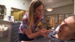 A nurse administers CBD oil to David Scholey, who has dementia, in Fenelon Falls, Ont.